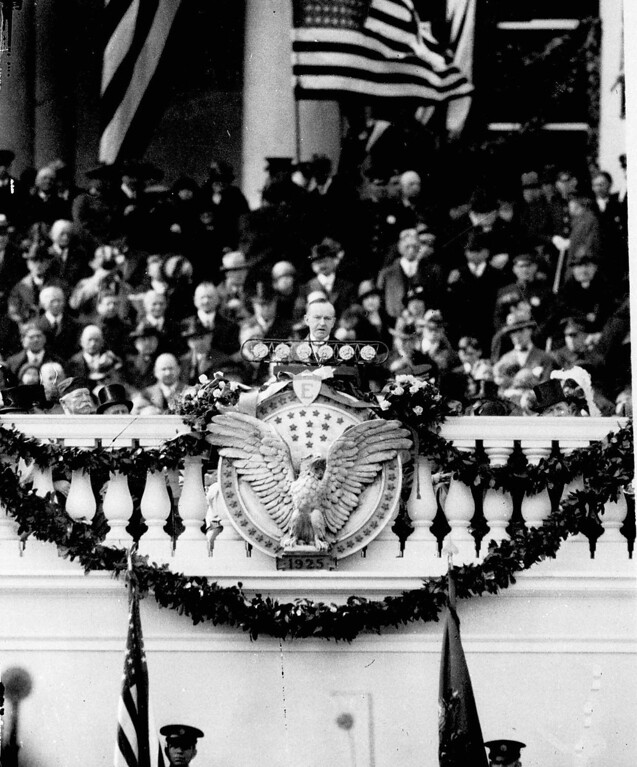 Description of . Calvin Coolidge at his inauguration March 4, 1925 as 30th President of the United States, delivers an address urging international cooperation, full responsibility, tax reform and respect of the law. (AP Photo)
