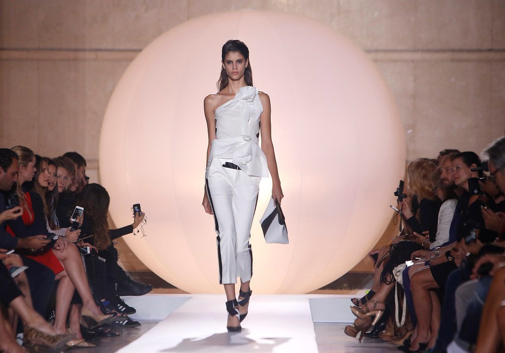 Description of . A model wears a creation for French fashion designer Roland Mouret's ready-to-wear Spring/Summer 2014 fashion collection, presented in Paris, Friday, Sept.27, 2013. (AP Photo/Thibault Camus)