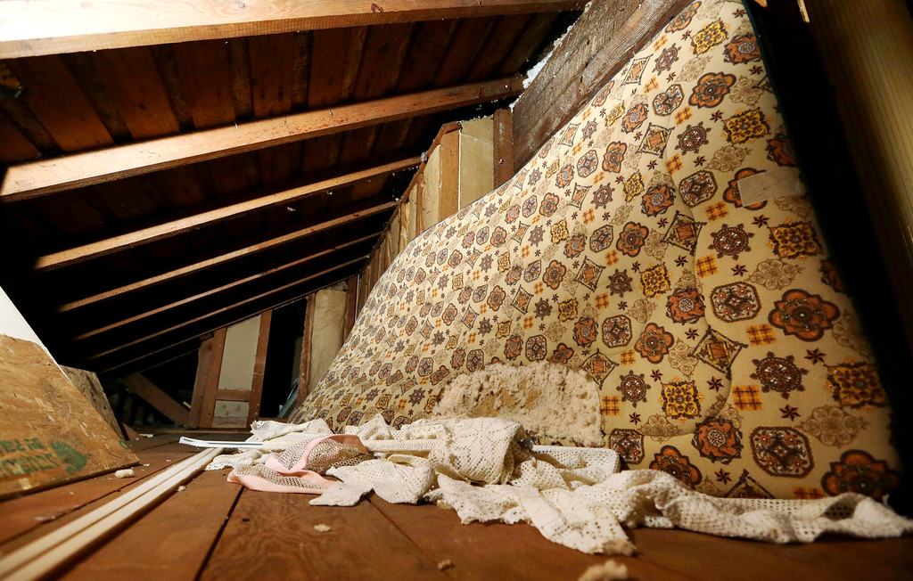 Description of . In this photo taken Monday, Sept. 23, 2013, a mattress used in childhood by Kurt Cobain, the late frontman of Nirvana, leans on the wall in an attic crawlspace of his family home in Aberdeen, Wash. (AP Photo/Elaine Thompson)