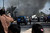 Smoke rises from the site of a bomb attack in Baghdad's Sadr City March 19, 2013. A dozen car bombs and suicide blasts tore into Shi'ite districts in Baghdad and south of the Iraqi capital on Tuesday, killing more than 50 people on the 10th anniversary of the U.S.-led invasion that ousted Saddam Hussein. REUTERS/Wissm al-Okili