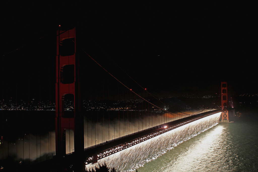 Description of . Fireworks explode over the Golden Gate Bridge on May 27, 2012 in San Francisco, California. The Golden Gate Bridge celebrated its 75th anniversary.  (Photo by Ezra Shaw/Getty Images)
