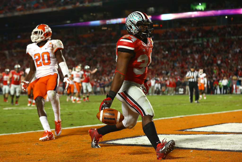 Description of . MIAMI GARDENS, FL - JANUARY 03: Carlos Hyde #34 of the Ohio State Buckeyes scores a touchdown in the fourth quarter against the Clemson Tigers during the Discover Orange Bowl at Sun Life Stadium on January 3, 2014 in Miami Gardens, Florida.  (Photo by Streeter Lecka/Getty Images)