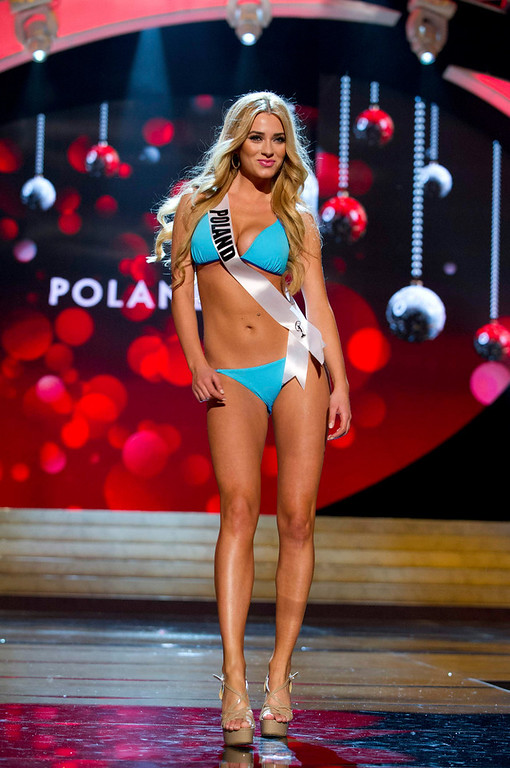 Description of . Miss Poland Marcelina Zawadzka competes in her Kooey Australia swimwear and Chinese Laundry shoes during the Swimsuit Competition of the 2012 Miss Universe Presentation Show at PH Live in Las Vegas, Nevada December 13, 2012. The 89 Miss Universe Contestants will compete for the Diamond Nexus Crown on December 19, 2012. REUTERS/Darren Decker/Miss Universe Organization/Handout