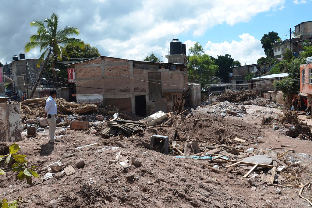 Description of . A neighborhood lays in ruins after flooding was triggered by Tropical Storm Manuel in Chilpancingo, Mexico, Thursday, Sept. 19, 2013.   (AP Photo/Alejandrino Gonzalez)
