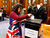 Falkland Islander Joan Turner, wearing a dress with the Union Jack colours, casts her vote at the Town Hall polling station in Stanley, March 10, 2013. Residents of the Falkland Islands started voting on Sunday in a sovereignty referendum that seeks to counter Argentina's increasingly assertive claim over the British-ruled territory. REUTERS/Marcos Brindicci