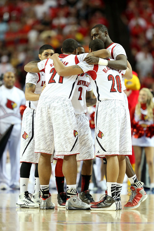 Description of . ATLANTA, GA - APRIL 06:  The starters for the Louisville Cardinals huddle up prior to playing against the Wichita State Shockers during the 2013 NCAA Men's Final Four Semifinal at the Georgia Dome on April 6, 2013 in Atlanta, Georgia.  (Photo by Andy Lyons/Getty Images)