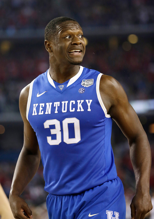 Description of . Kentucky forward Julius Randle reacts during the first half of an NCAA Final Four tournament college basketball semifinal game against Wisconsin Saturday, April 5, 2014, in Arlington, Texas. (AP Photo/David J. Phillip)