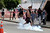 A supporter of the native Indian community kicks a tear gas canister near the Brazilian Indian Museum in Rio de Janeiro March 22, 2013. Brazilian military police took position early morning outside the abandoned Indian museum, where a native Indian community of around 30 individuals have been living since 2006. The Indians were summoned to leave the museum in 72 hours by court officials since last week, local media reported. The group is fighting against the destruction of the museum, which is next to the Maracana Stadium. REUTERS/Sergio Moraes