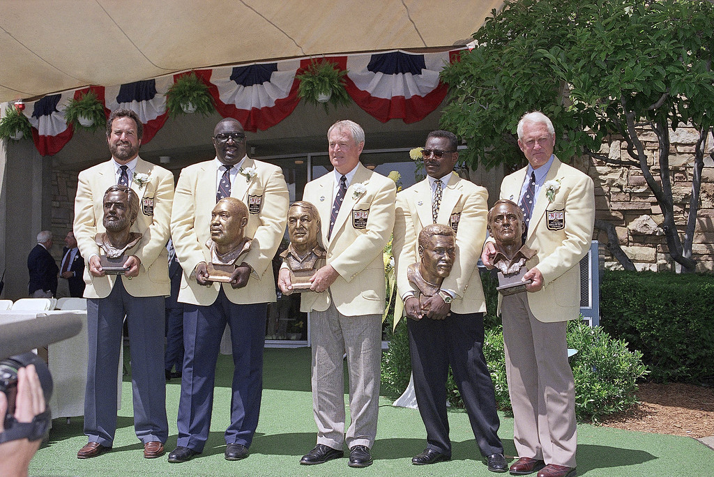 . The 1993 class of inductees pose with their busts in front of the Pro Football Hall of Fame on Saturday, July 31, 1993 in Canton, Ohio. From left: Dan Fouts, Larry Little, Chuck Noll, Walter and Bill Walsh. (AP Photo/Bruce Zake)