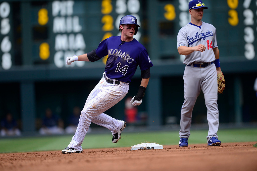 Description of . Josh Rutledge (14) of the Colorado Rockies rounds second base after stealing on a wild pitch by Clayton Kershaw (22) of the Los Angeles Dodgers during the action in Denver on Monday, September 2, 2013. The Colorado Rockies hosted the Los Angeles Dodgers at Coors Field.   (Photo by AAron Ontiveroz/The Denver Post)