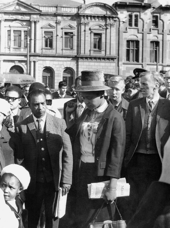 Description of . Winnie Mandela (C), leaves the Palace of Justice in Pretoria 16 June 1964 with her fist clenched, after the verdict of the Rivonia Trial was given, sentencing eight men, including her husband anti-apartheid leader and African National Congress (ANC) member Nelson Mandela, to life imprisonment. The men were charged with conspiracy, sabotage and treason. (Photo credit should read OFF/AFP/Getty Images)