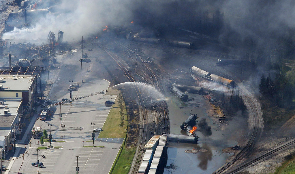 Description of . The wreckage of a train is pictured after an explosion in Lac Megantic July 6, 2013. Several people were missing after four tank cars of petroleum products exploded in the middle of a small town in the Canadian province of Quebec early on Saturday in a fiery blast that destroyed dozens of buildings.  REUTERS/Mathieu Belanger