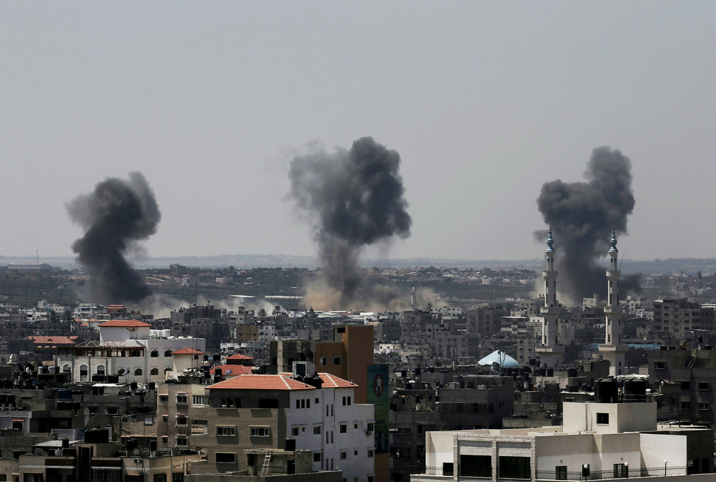 Description of . Smoke rises after Israeli missile strikes hit the northern Gaza Strip, Wednesday, July 16, 2014. A Hamas website says Israel has fired missiles at the homes of four of its senior leaders as it resumed bombardment of Gaza, following a failed Egyptian cease-fire effort. Wednesday's bombings came after Hamas rejected an Egyptian truce proposal on Tuesday and instead launched more rockets at Israel. (AP Photo/Adel Hana)