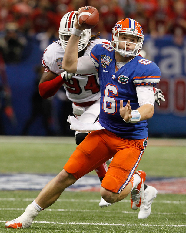 Description of . Florida quarterback Jeff Driskel (6) is pursued by Louisville defensive end Lorenzo Mauldin (94) in the first half of the Sugar Bowl NCAA college football game Wednesday, Jan. 2, 2013, in New Orleans. (AP Photo/Butch Dill)