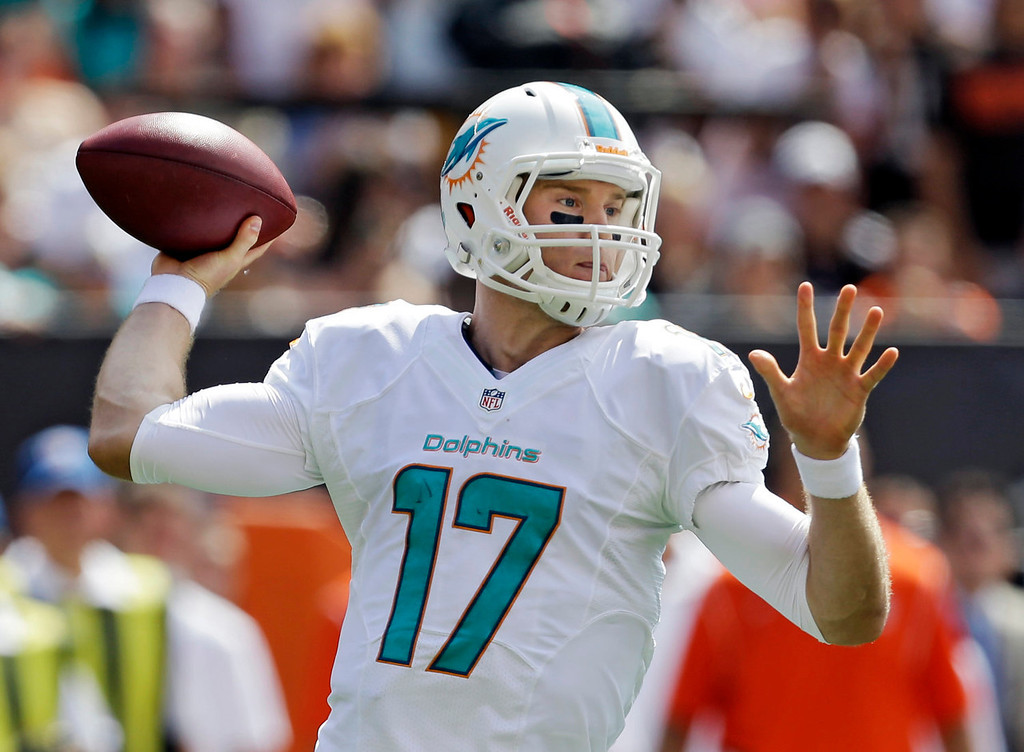 Description of . Miami Dolphins quarterback Ryan Tannehill passes against the Cleveland Browns in the first quarter of an NFL football game Sunday, Sept. 8, 2013, in Cleveland. (AP Photo/Tony Dejak)