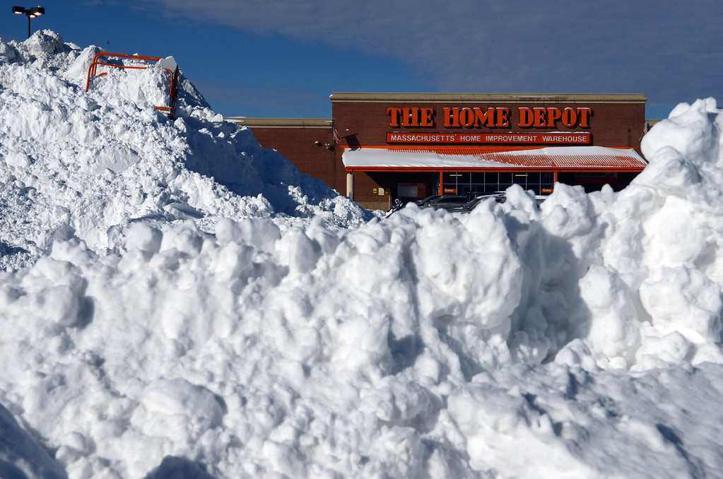 Description of . Snow is piled up high in front of Home Depot in the South Bay shopping center after a two day winter storm January 4, 2014 in Boston, Massachusetts. The storm began mid day Thursday with heavy snows overnight into Friday bringing with it extreme cold. (Photo by Darren McCollester/Getty Images)