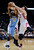 Denver Nuggets' Corey Brewer (13) is fouled by Houston Rockets' Omer Asik (3) as Rockets' Carlos Delfino (10) is caught in the middle during the second half of an NBA basketball game Wednesday, Jan. 23, 2013, in Houston. Denver won 105-95. (AP Photo/Pat Sullivan)