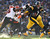 Ben Roethlisberger #7 of the Pittsburgh Steelers tries to outrun the tackle of Carlos Dunlap #96 of the Cincinnati Bengals during the second quarter at Heinz Field on December 23, 2012 in Pittsburgh, Pennsylvania. (Photo by Gregory Shamus/Getty Images)