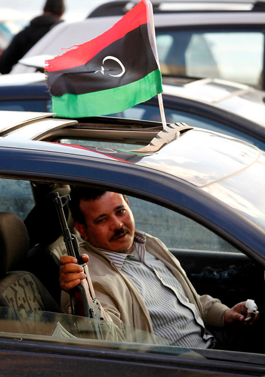 Description of . In this Friday, Feb. 15, 2013 photo, a former Libyan rebel shows off his weapon during a celebration in the streets to commemorate the second anniversary of the revolution that  ousted Moammar Gadhafi, in Benghazi, Libya, Friday, Feb, 15, 2013. (AP Photo/Mohammad Hannon)