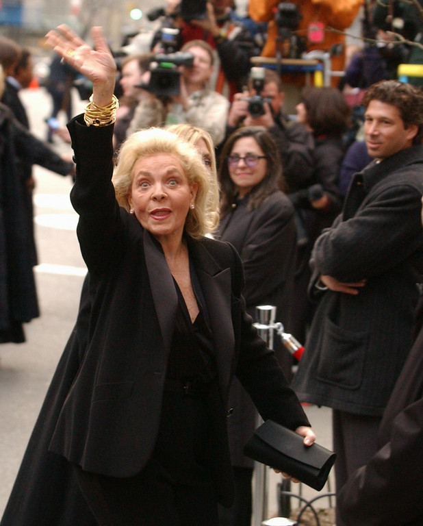 . FILE - This March 16, 2002 file photo shows actress Lauren Bacall waving as she enters Marble Collegiate Church in New York for the wedding of Liza Minnelli and David Gest. Bacall, the sultry-voiced actress and Humphrey Bogart�s partner off and on the screen, died Tuesday, Aug. 12, 2014 in New York. She was 89. (AP Photo/Ed Betz, File)