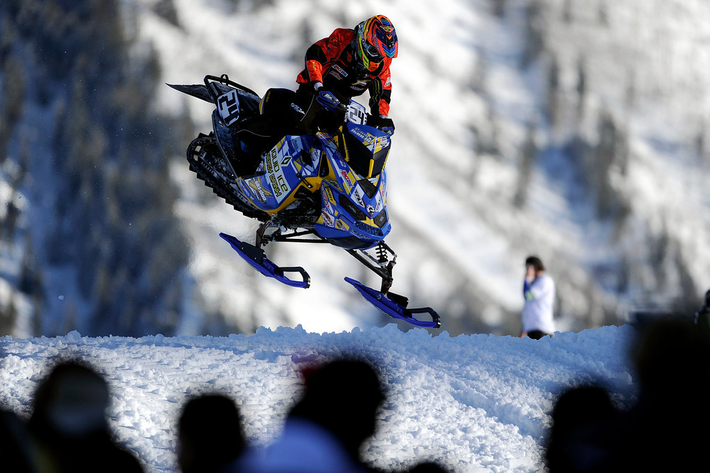 Description of . ASPEN, CO - January 27: Paul Bauerly comes over the final jump during the snowmobile SnoCross event at Winter X Games Aspen 2013 at Buttermilk Mountain on Jan. 27, 2013, in Aspen, Colorado. Bauerly finished 13th overall. (Photo by Daniel Petty/The Denver Post)