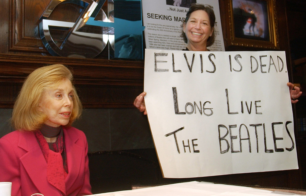 "Description of . Irene Feldman, right, the woman who held up the handwritten sign: ""Elvis is dead. Long live the Beatles.\"" outside New York\'s Plaza Hotel in 1964, and psychologist Dr. Joyce Brothers participate in a New York news conference Friday Jan. 16, 2004. The Fab 40 Committee, a loosely-knit group of Beatles fans and friends, held the conference to promote the events marking the famed Feb. 9, 1964, appearance by the Fab Four on \""The Ed Sullivan Show.\""  (AP Photo/Richard Drew)"