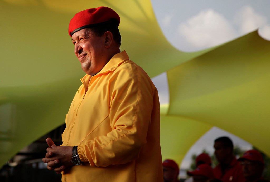 Description of . In this July 14, 2012 file photo, Venezuela's President Hugo Chavez smiles at a campaign rally in Barquisimeto, Venezuela. When he takes the stage at campaign rallies, Chavez stands alone. Under Venezuela's election system, presidential hopefuls donít choose running mates. The lack of a No. 2 leaves voters with a big unknown ahead of next month's presidential election and raises question about who in fact would take over were Chavez to win and leave office prematurely. (AP Photo/Ariana Cubillos,File)