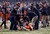 Ryan Nassib #12 of the Syracuse Orange is helped back to his feet after being sacked by the West Virginia Mountaineers in the New Era Pinstripe Bowl at Yankee Stadium on December 29, 2012 in the Bronx borough of New York City.  (Photo by Jeff Zelevansky/Getty Images)