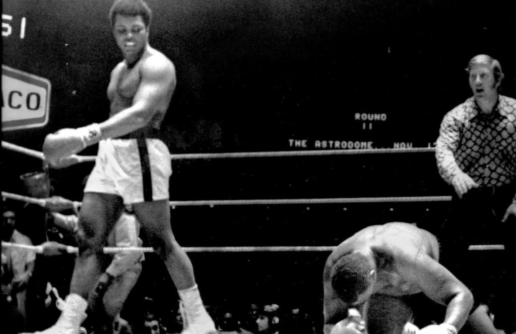 Description of . Muhammad Ali grimaces as ken Norton connects with a left the chin during their 12-round heavyweight bout at the sports arena in San Diego , Calif. Ali lost on a split decision. 1971. Denver Post Library photo archive