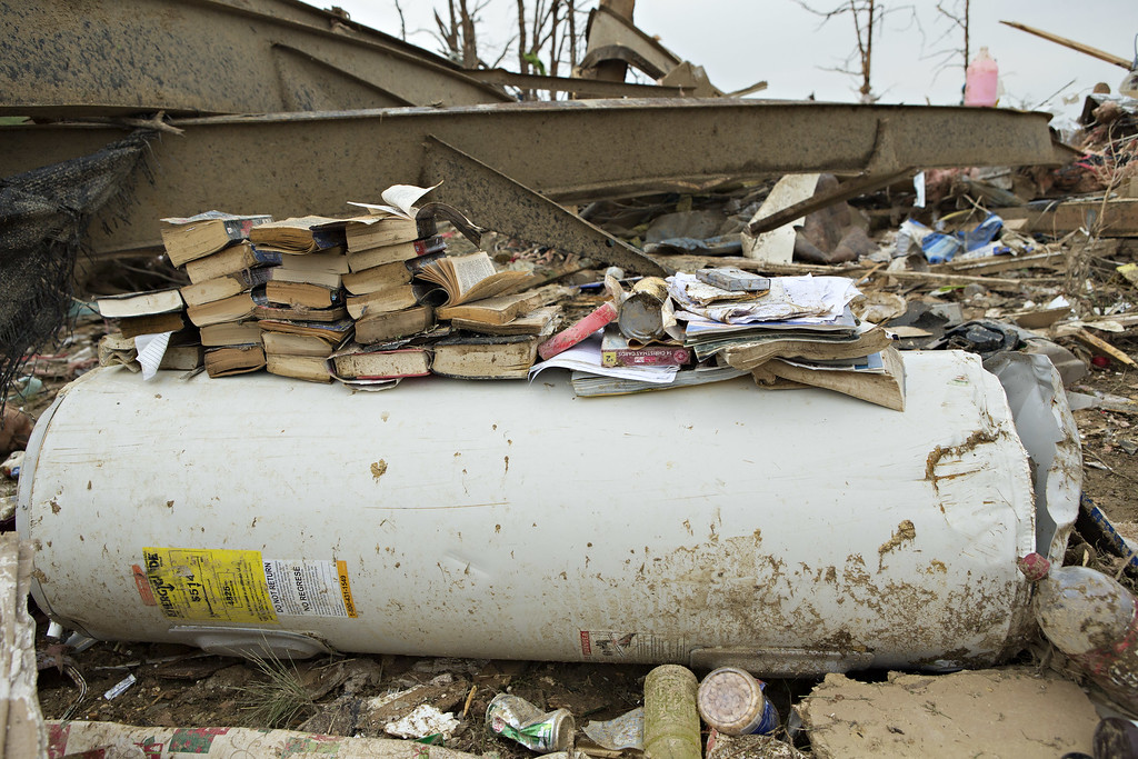 Description of . Books are stacked on a water heater after a strong tornado went through the area on April 27 for the second time in three years on April 28, 2014 in Vilonia, Arkansas. After deadly tornadoes ripped through the area and have left over a dozen dead, Mississippi, Arkansas, Texas, Louisiana, and Tennessee are all under watch as multiple storms over the next few days are expected.  (Photo by Wesley Hitt/Getty Images)