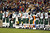 NASHVILLE, TN - DECEMBER 17:  The New York Jets stand on the sideline in a moment in silence for the victims of the mass shooting that took place at Sandy Hook elementary school in Newtown, Connecticut prior to the game against the Tennessee Titans at LP Field on December 17, 2012 in Nashville, Tennessee.  (Photo by Andy Lyons/Getty Images)