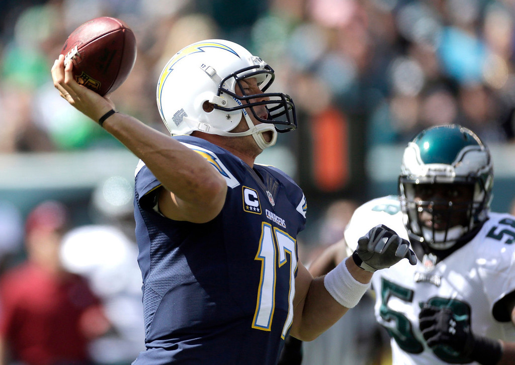 Description of . San Diego Chargers' Philip Rivers looks to pass during the first half of an NFL football game against the Philadelphia Eagles, Sunday, Sept. 15, 2013, in Philadelphia. (AP Photo/Matt Rourke)