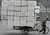 A migrant worker pulls a cart loaded with discarded plastic foam for recycling in Nanjing, Jiangsu province February 7, 2009.REUTERS/Sean Yong