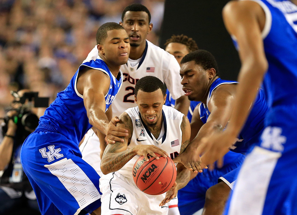 Description of . ARLINGTON, TX - APRIL 07: Aaron Harrison #2 of the Kentucky Wildcats defends against Ryan Boatright #11 of the Connecticut Huskies during the NCAA Men\'s Final Four Championship at AT&T Stadium on April 7, 2014 in Arlington, Texas.  (Photo by Jamie Squire/Getty Images)