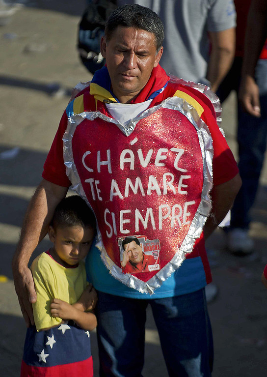 Description of . A supporter of the late President Hugo Chavez is seen outside of his funeral wearing a heart that reads