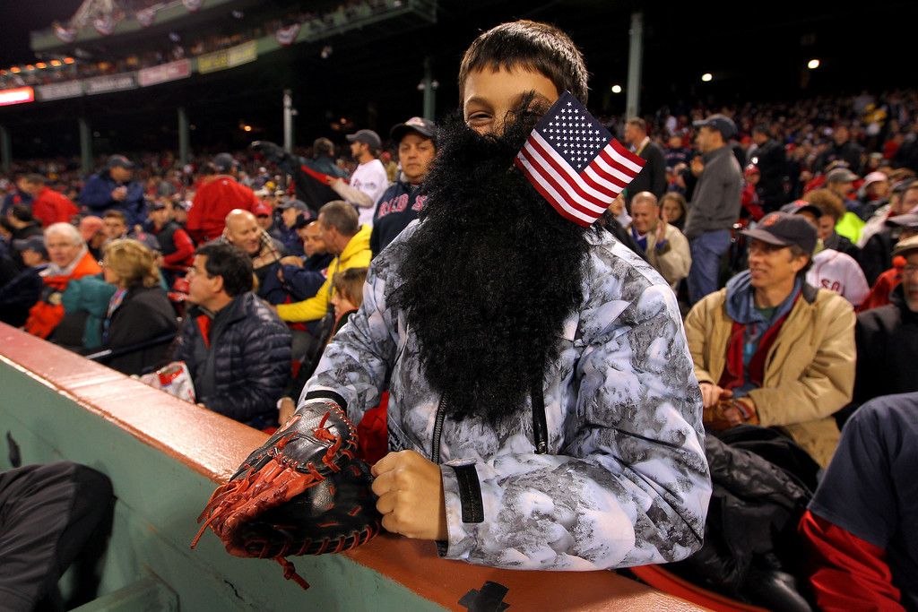 Description of . A fan poses for a photo during Game One of the 2013 World Series between the Boston Red Sox and the St. Louis Cardinals at Fenway Park on October 23, 2013 in Boston, Massachusetts.  (Photo by Jamie Squire/Getty Images)