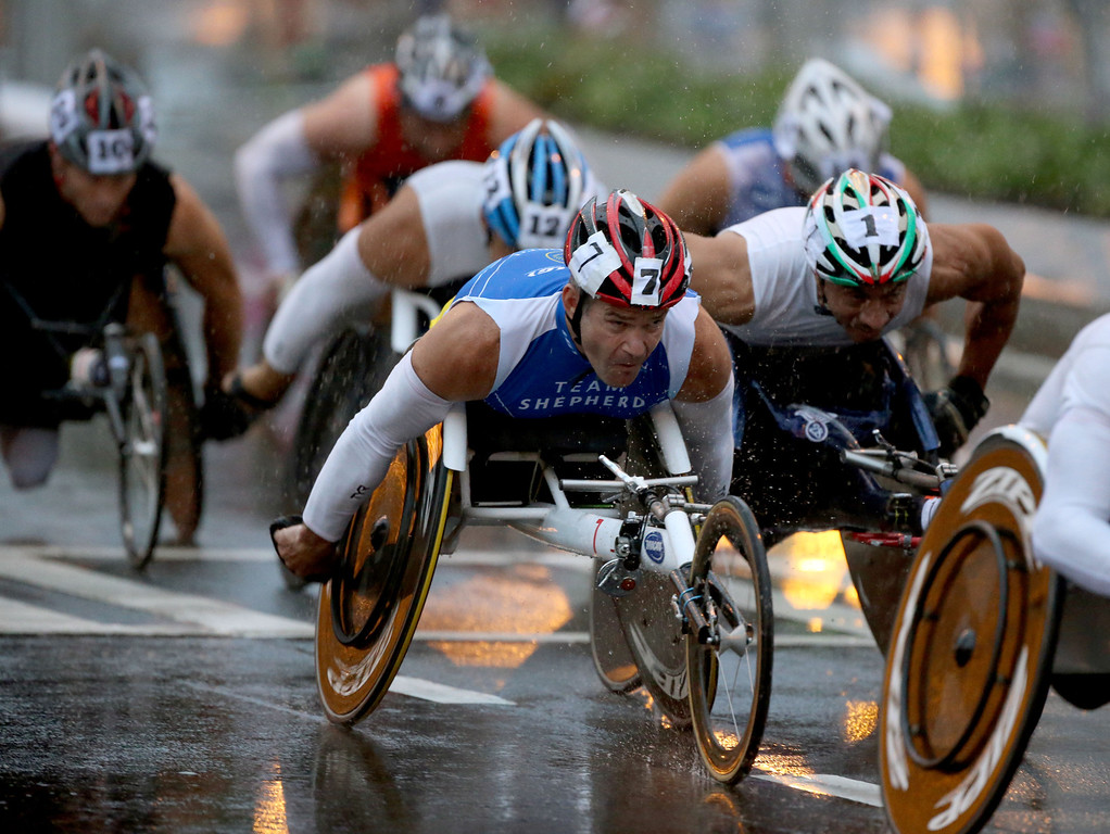 Description of . Richard Coleman, of Austraila, competes in the Men's Open Wheelchair Division of the 44th running of the AJC Peachtree Road Race at Lenox Square Thursday morning in Atlanta, Ga., July 4, 2013.  The 10K race is a Fourth of July tradition in Atlanta that's billed as the largest road race in the U.S.     (AP Photo/Atlanta Journal-Constitution, Jason Getz)