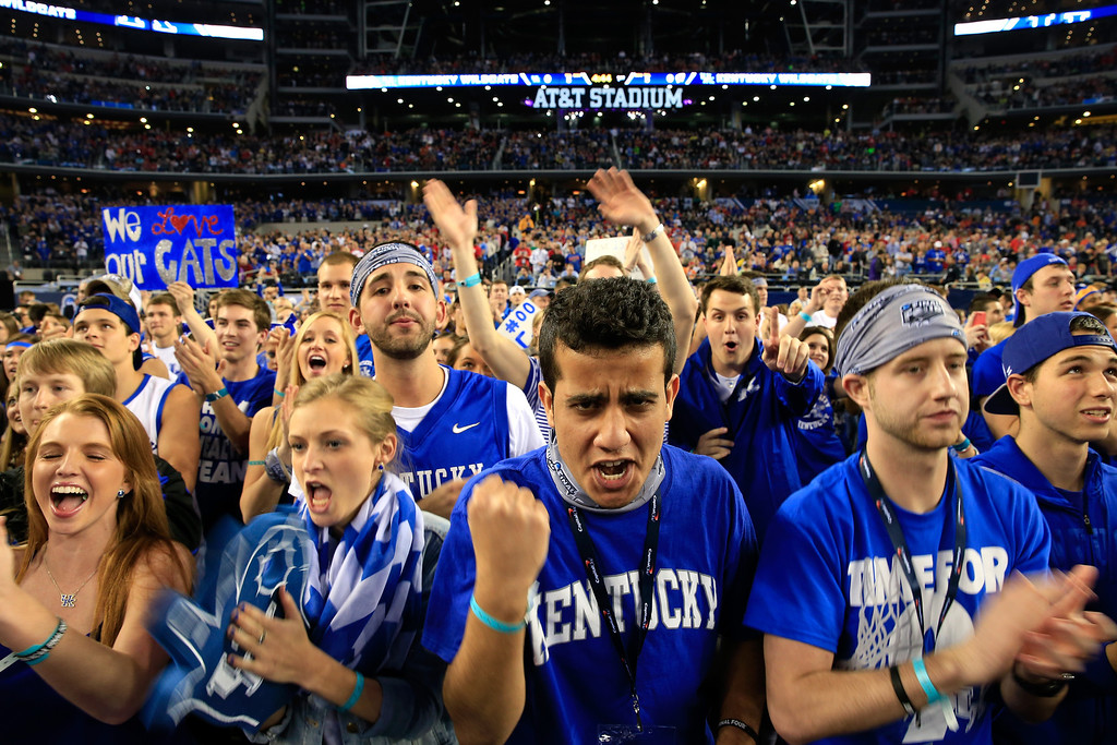 Description of . ARLINGTON, TX - APRIL 05:  Kentucky Wildcats fans cheer prior to the NCAA Men's Final Four Semifinal against the Wisconsin Badgers at AT&T Stadium on April 5, 2014 in Arlington, Texas.  (Photo by Jamie Squire/Getty Images)