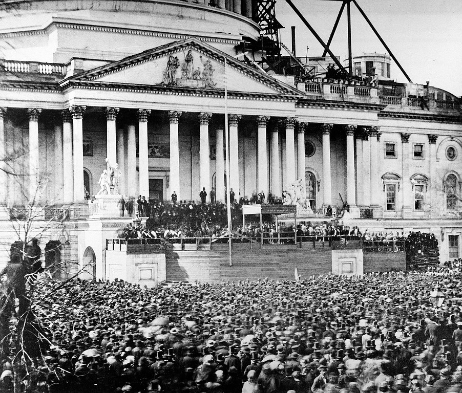 Description of . U.S. President Abraham Lincoln stands under cover at the center of Capitol steps during his inauguration in Washington, D.C., on March 4, 1861. The scaffolding at upper right was used in construction of the Capitol dome. (AP Photo)