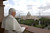 Pope Benedict XVI stands looking outside his new apartment with St. Peter's Basilica in the background April 20, 2005 in Vatican City. Cardinal Ratzinger was elected the new Pope on April 19.  (Photo by Arturo Mari-Pool/Getty Images)