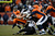 Denver Broncos quarterback Peyton Manning (18) gets taken down in the third quarter. The Denver Broncos vs Baltimore Ravens AFC Divisional playoff game at Sports Authority Field Saturday January 12, 2013. (Photo by Joe Amon,/The Denver Post)