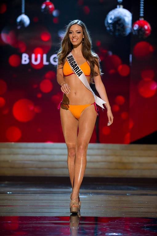 Description of . Miss Bulgaria Zhana Yaneva competes in her Kooey Australia swimwear and Chinese Laundry shoes during the Swimsuit Competition of the 2012 Miss Universe Presentation Show at PH Live in Las Vegas, Nevada December 13, 2012. The 89 Miss Universe Contestants will compete for the Diamond Nexus Crown on December 19, 2012. REUTERS/Darren Decker/Miss Universe Organization/Handout