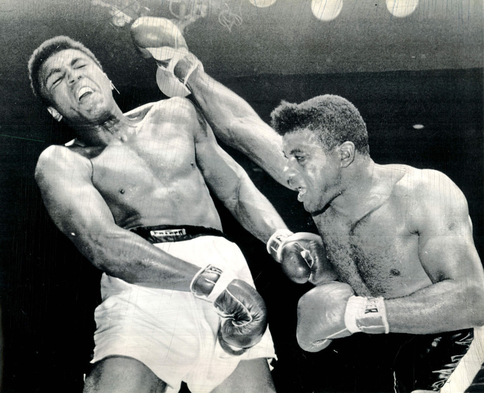 Description of . Floyd Patterson shoots a straight right but champion Cassius Clay ducks back and takes blow on shoulder in their heavyweight title fight at Las Vegas.  Clay got in almost all effective punches to win by a TKO in the 12th round.  1965. Credit: AP