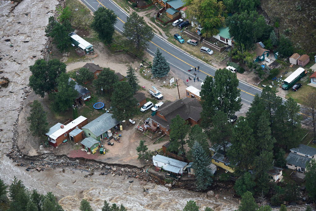 Description of . People stranded along a stretch of U.S. 34 along the Big Thompson River in the Big Thompson Canyon in Larimer County Colorado Saturday morning, September 14, 2013 due to recent flooding. U.S. 34 was washed out on both sides of them and were awaiting rescue. (Photo By Andy Cross/The Denver Post)