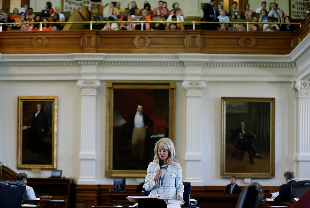 Description of . Sen. Wendy Davis, D-Fort Worth, speeks during her filibuster of an abortion bill, Tuesday, June 25, 2013, in Austin, Texas. The bill will get another chance next week now that the Gov. Rick Perry has called another special legislative session.  (AP Photo/Eric Gay)
