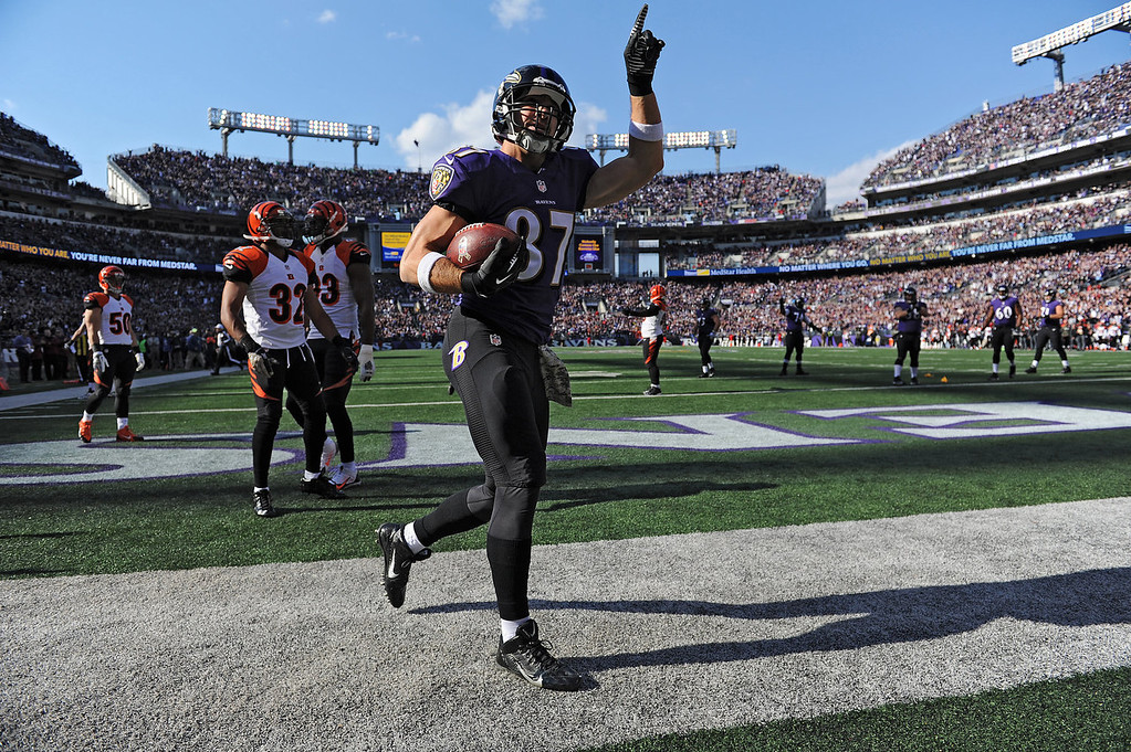 Description of . Tight end Dallas Clark #87 of the Baltimore Ravens celebrates after scoring a touchdown against the Cincinnati Bengals in the first quarter at M&T Bank Stadium on November 10, 2013 in Baltimore, Maryland. (Photo by Patrick Smith/Getty Images)