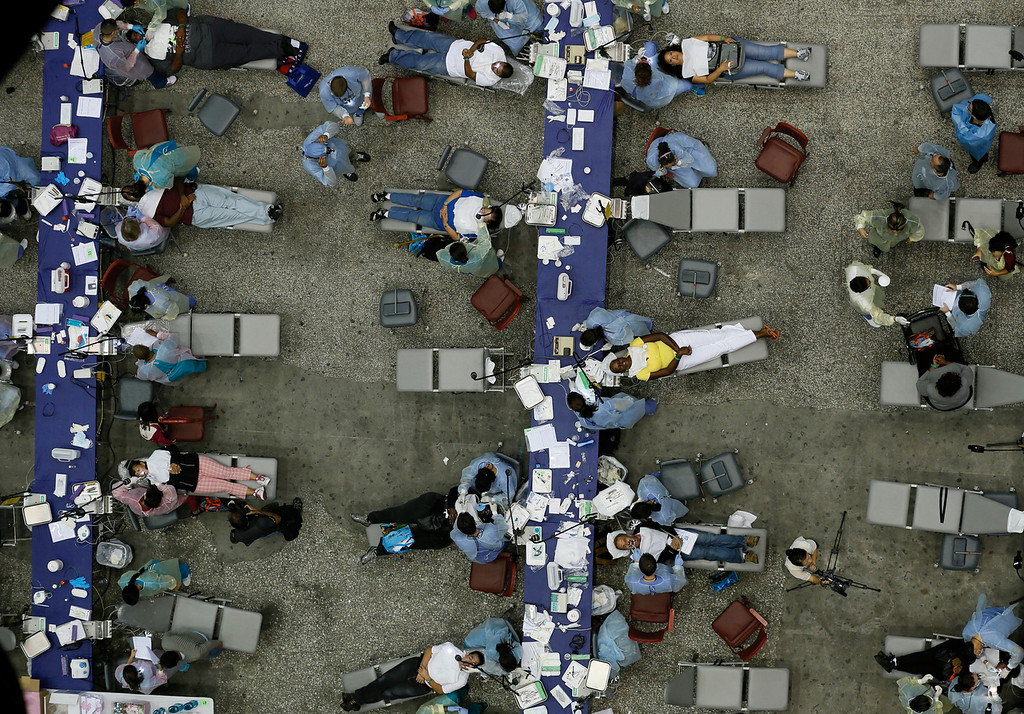 Description of . People receive dental treatment at the Care Harbor/LA free clinic in Los Angeles September 27, 2012. The clinic will give an estimated 4,800 patients free dental work, medical exams, screenings and immunizations over four days.  REUTERS/Lucy Nicholson
