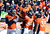 Denver Broncos wide receiver Trindon Holliday (11) celebrates with teammates after scoring a touchdown on an 89 yard punt return early in the first quarter.  The Denver Broncos vs Baltimore Ravens AFC Divisional playoff game at Sports Authority Field Saturday January 12, 2013. (Photo by John Leyba,/The Denver Post)