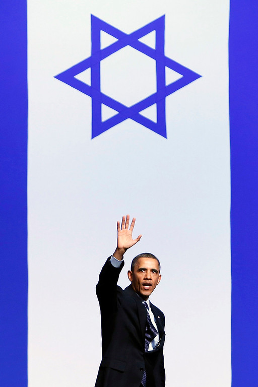 Description of . U.S. President Barack Obama waves after addressing Israeli students at the International Convention Center in Jerusalem March 21, 2013. Obama appealed directly on Thursday to the Israeli people to put themselves in the shoes of stateless Palestinians and recognise that Jewish settlement activity in occupied territory hurts prospects for peace. REUTERS/Baz Ratner