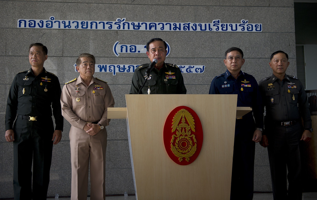 Description of . Thai Army chief General Prayut Chan-O-Cha (C) speaks during a press conference at the Army Club in Bangkok on May 20, 2014. Thailand's army declared martial law after months of deadly anti-government protests, deploying armed troops in central Bangkok and censoring the media but insisting the move was